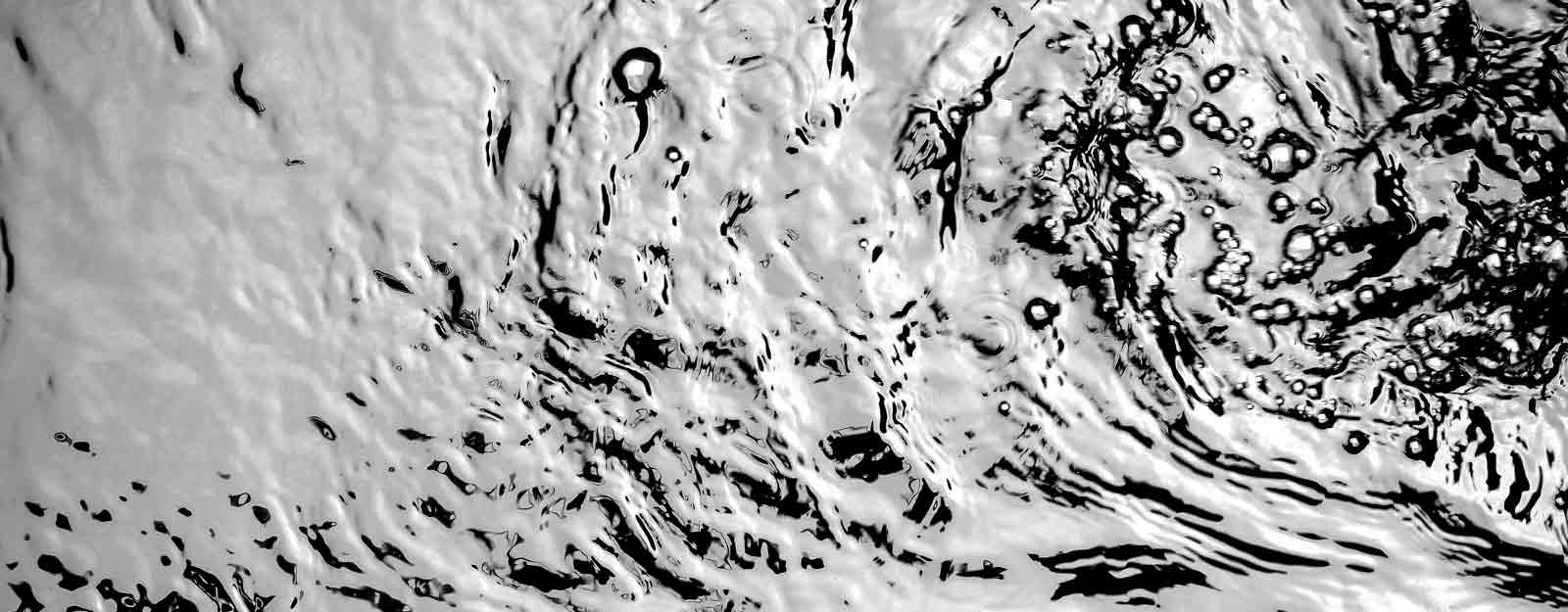 Photo of an agitated water surface.