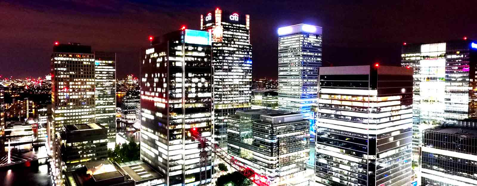 Photo of buildings in the London city docklands at night.